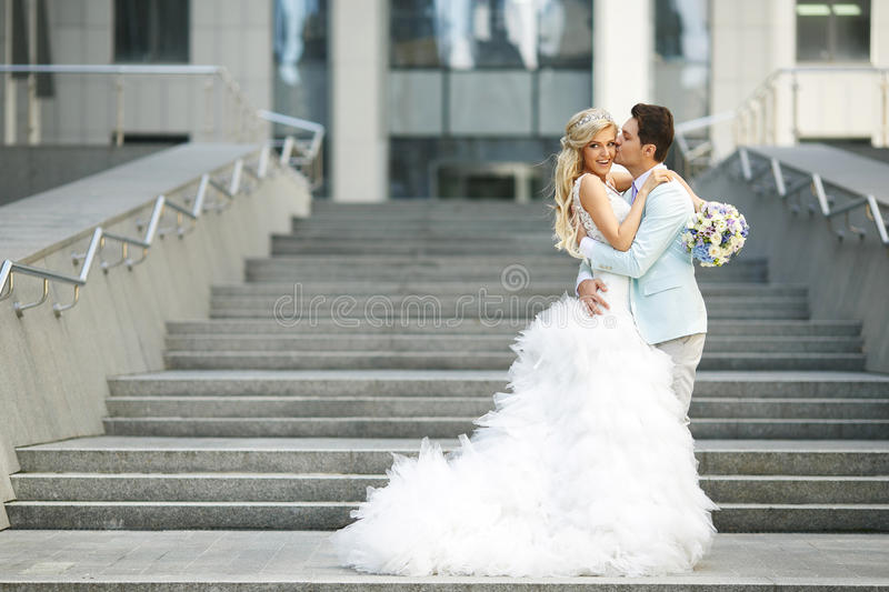 Bride and groom near the stairs royalty free stock photo