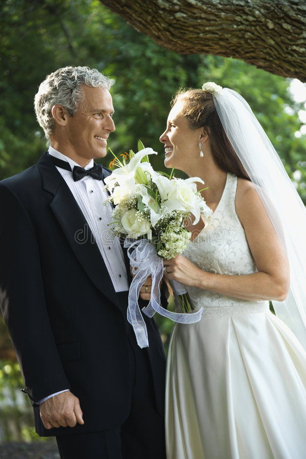 Bride and groom outdoors. stock photo