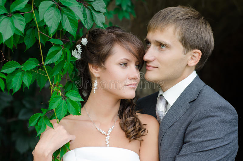 Bride and groom outdoors park closeup portrait stock photo