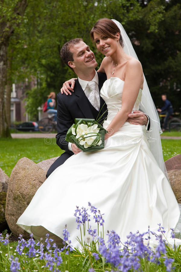 Bride and groom in the park royalty free stock photo