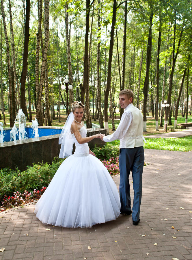 Bride and groom in a park royalty free stock photography