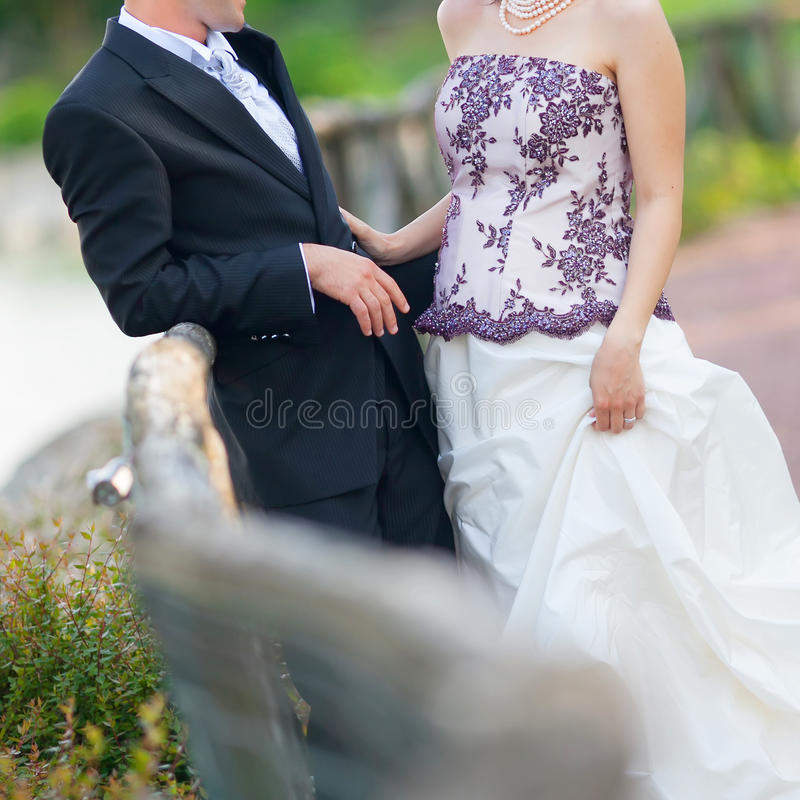 Bride and groom in the garden stock images