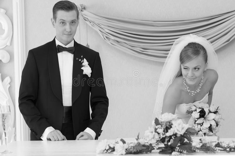 Bride with groom registering their marriage stock photos