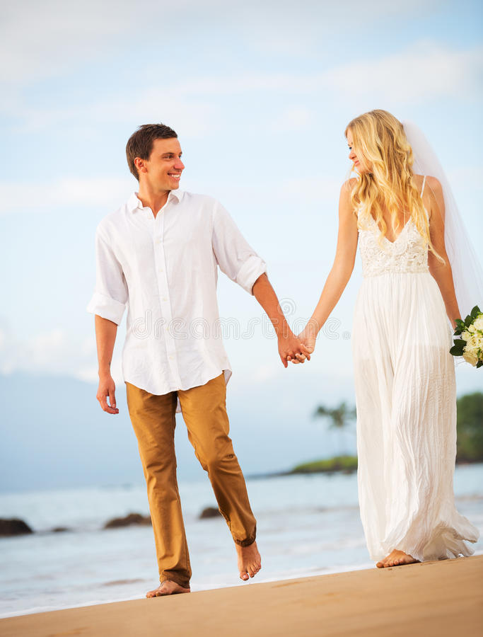 Download Bride And Groom, Romantic Newly Married Couple Holding Hands Wal Stock Photo - Image: 36074232