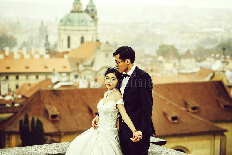 Bride and groom on roof royalty free stock images