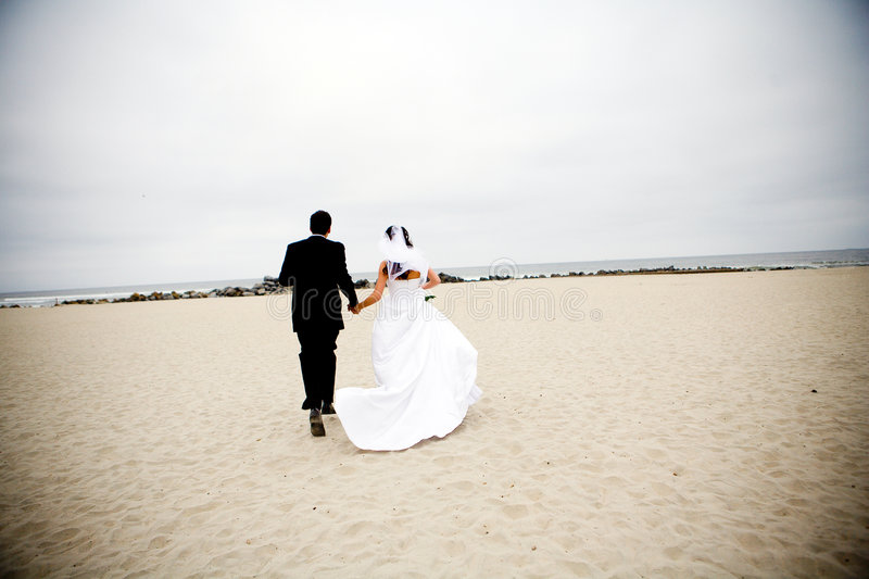 Bride and Groom Running royalty free stock photo
