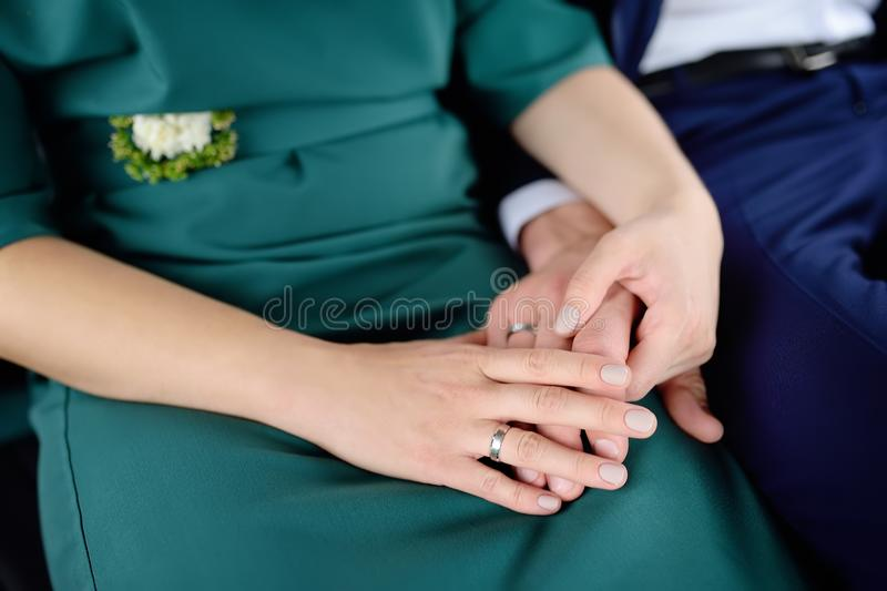 Bride and groom`s hands with wedding rings royalty free stock photo