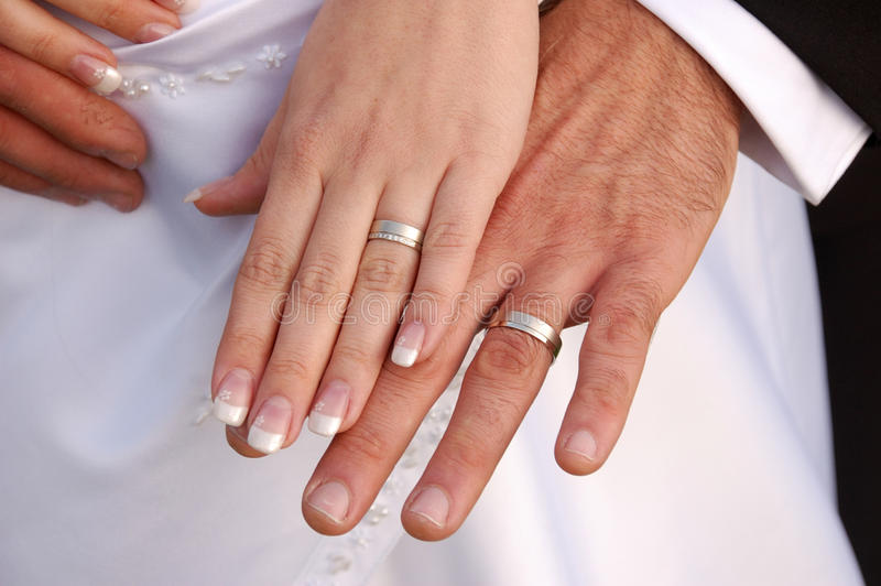 Bride And Groom Showing Their Wedding Rings Stock Photo