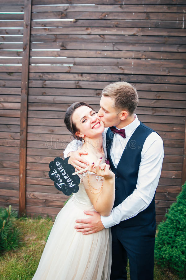 Bride and groom with a sign just married . sweet wedding details on the wedding day .Wedding couple stock photography