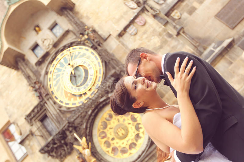 Bride And Groom Smiling In Front Of Cathedral Stock Photo