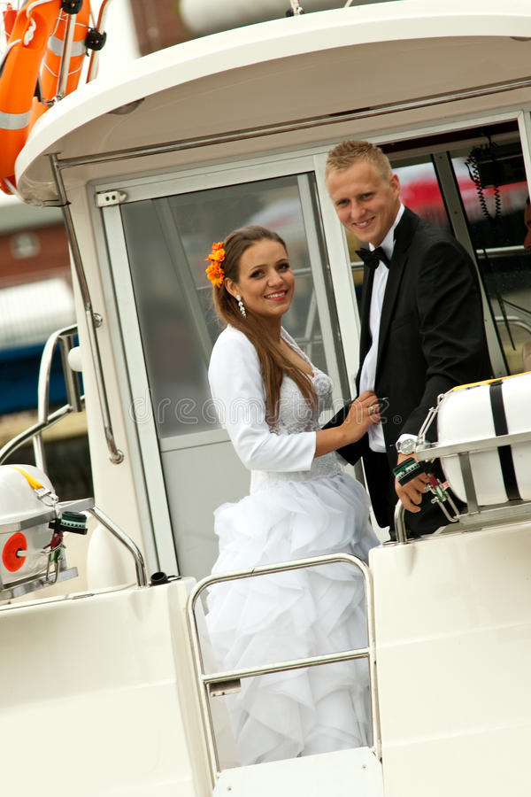 Bride and groom on speedboat royalty free stock photography