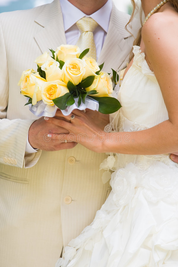 Bride and groom stand near each other with bouquet royalty free stock photos