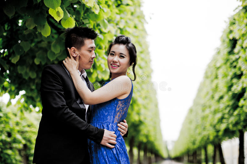 Bride and groom on their wedding day. Outdoors royalty free stock photo