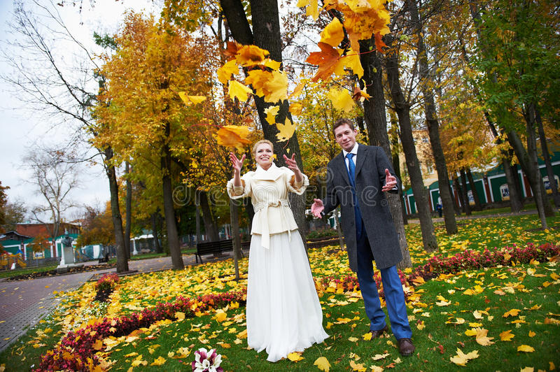 Download Bride And Groom Throw Maple Leaves Stock Image - Image: 22871571