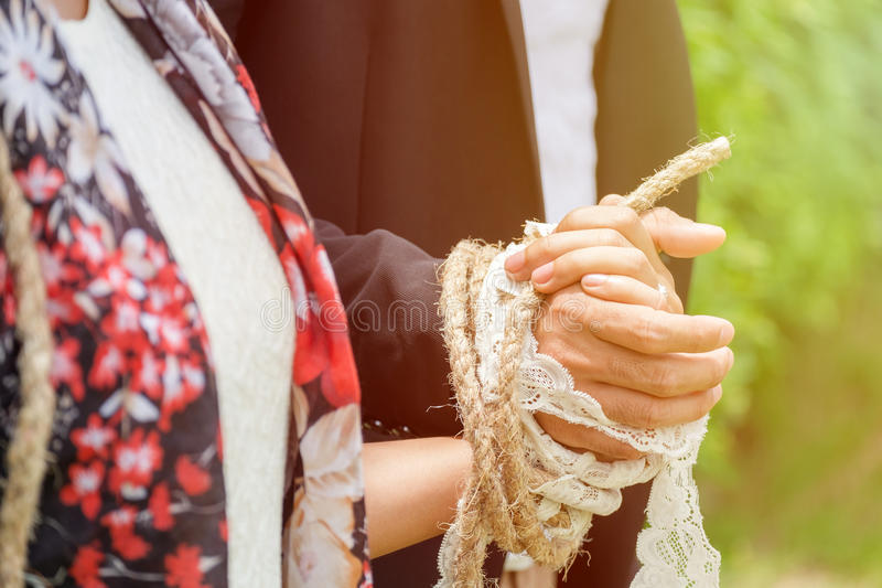 Bride and Groom Tied up together, concept of Deep Connection. More than Love stock photos