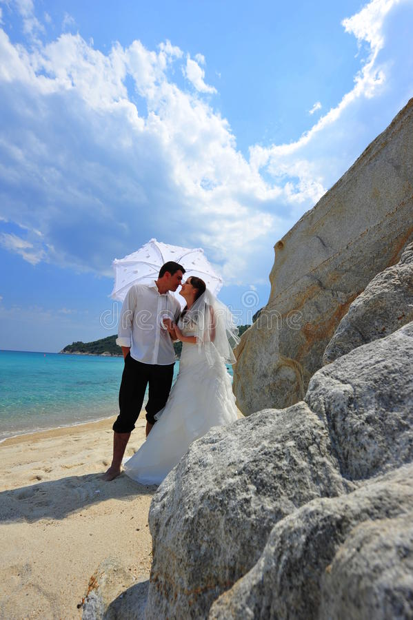 Download Bride And Groom On Tropical Beach Under Umbrella Stock Image - Image: 20767809