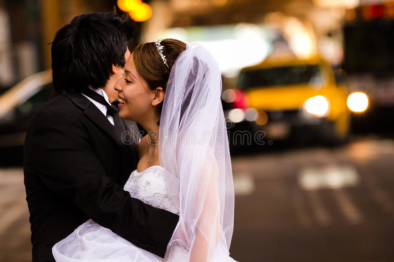 Happy Bride and Groom in Urban Environment royalty free stock photo