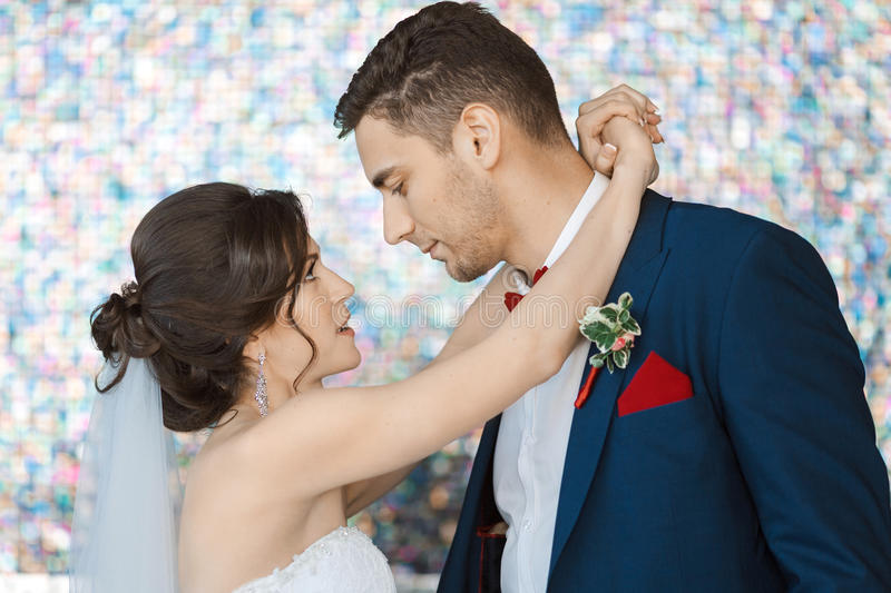 Bride and groom in very bright colored room stock photo