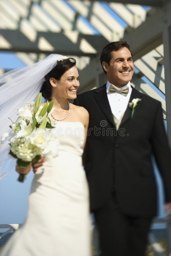 Bride and groom walking. stock images