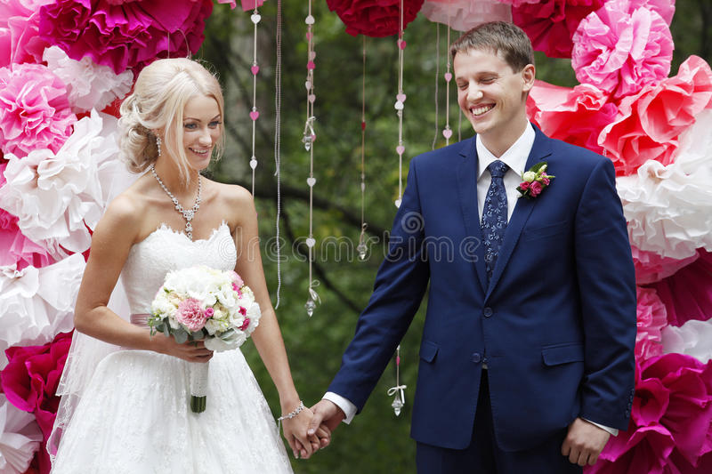 The bride and groom on the wedding ceremony royalty free stock images