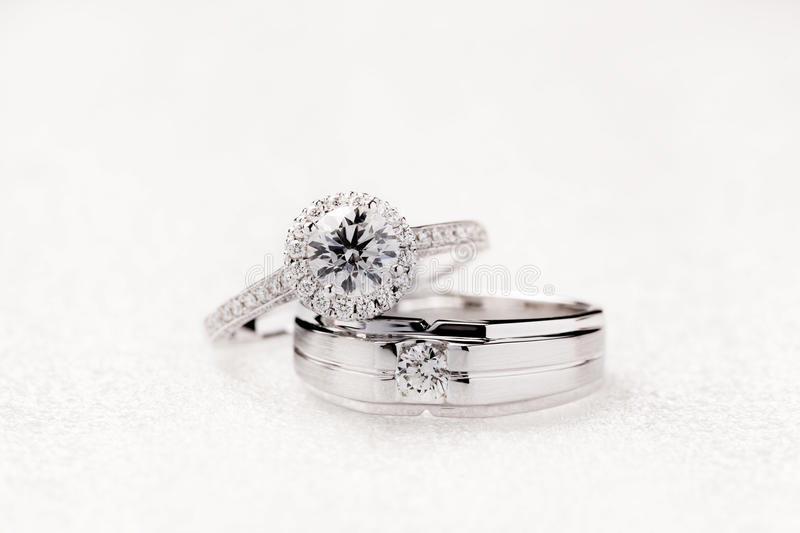 Bride and groom wedding engagement rings on white background royalty free stock photography