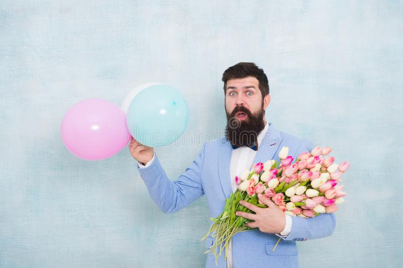 Bride groom at wedding party. love date with flowers. womens day. Formal surprised mature businessman spring bouquet. 8. March. bearded man in bow tie with stock image