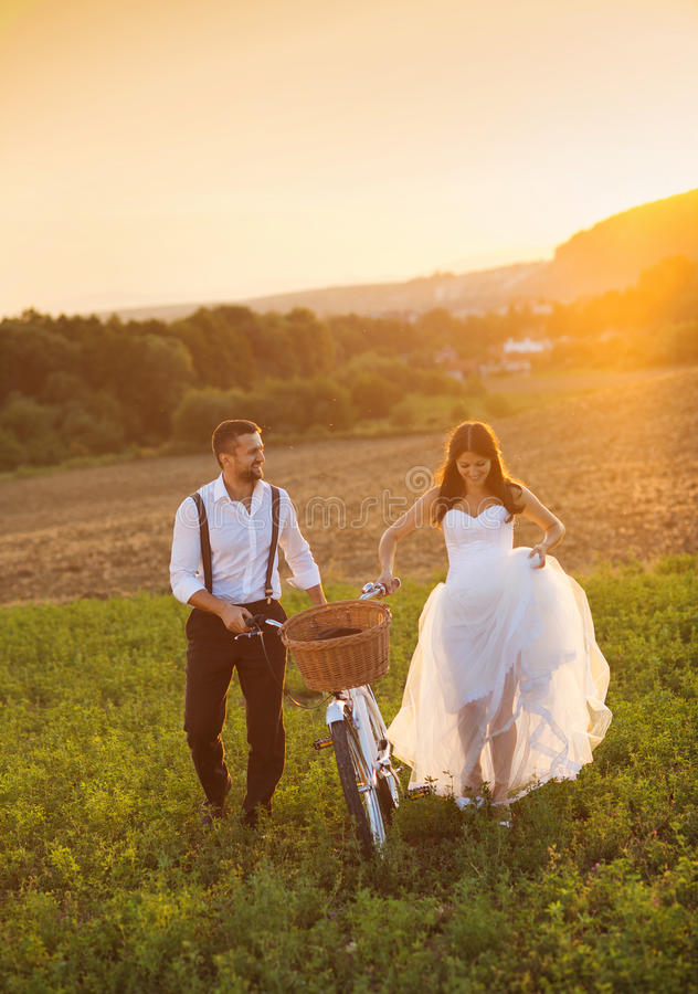 Bride and groom with a white wedding bike royalty free stock photography