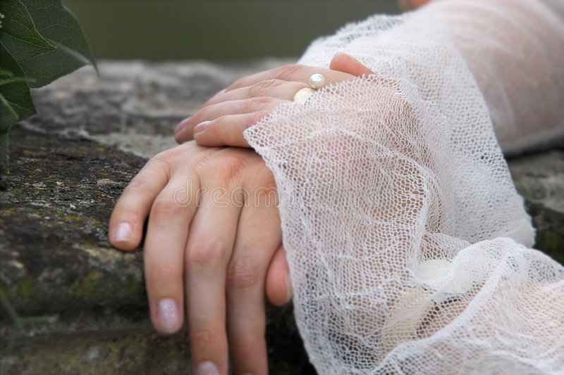 Bride, hands and pearl. Pearl ring on the bride's hand royalty free stock images