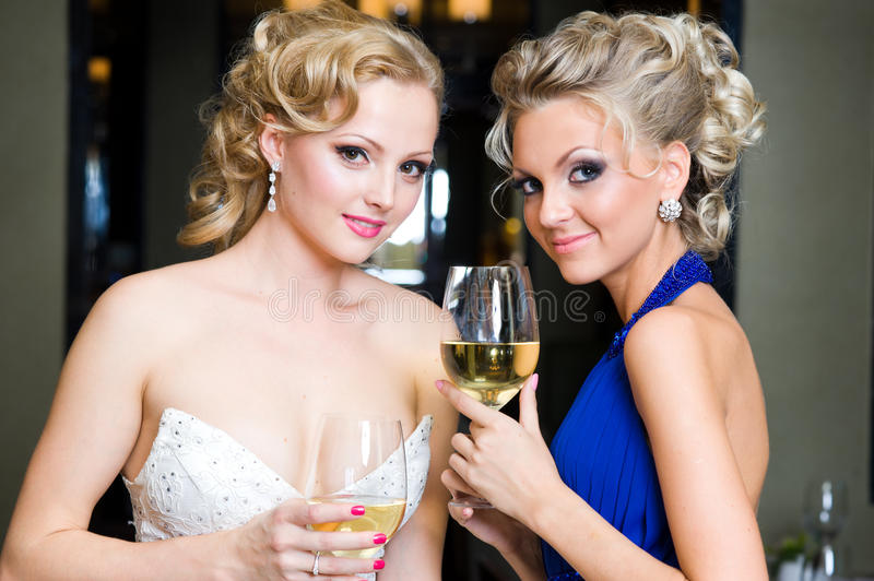 Bride and her Bridesmaid in a restaurant stock images