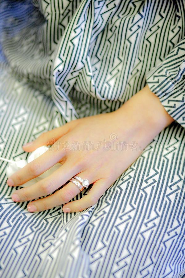 A bride with her ring wearing a striped pattern pajamas stock images