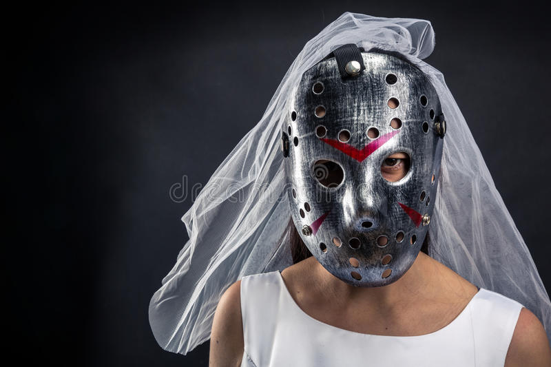 Bride in hockey mask serial murederer royalty free stock images