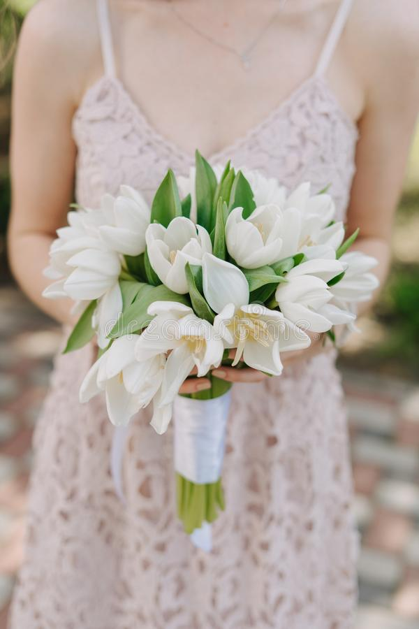 Bride Hold in Hand Tulip Wedding Bouquet Outside stock photography
