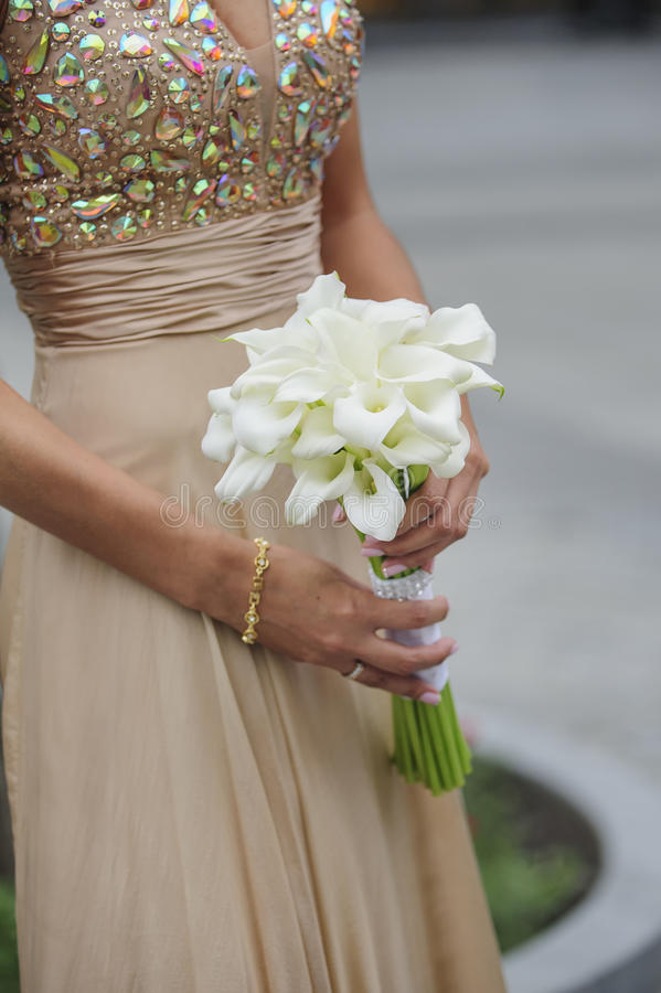 Bride hold her calla wedding bouquet royalty free stock image