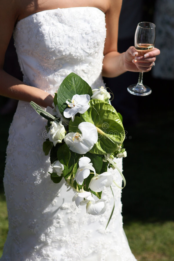 Free Bride Holding A Bouquet Of Flowers And Drink Stock Image - 1070421