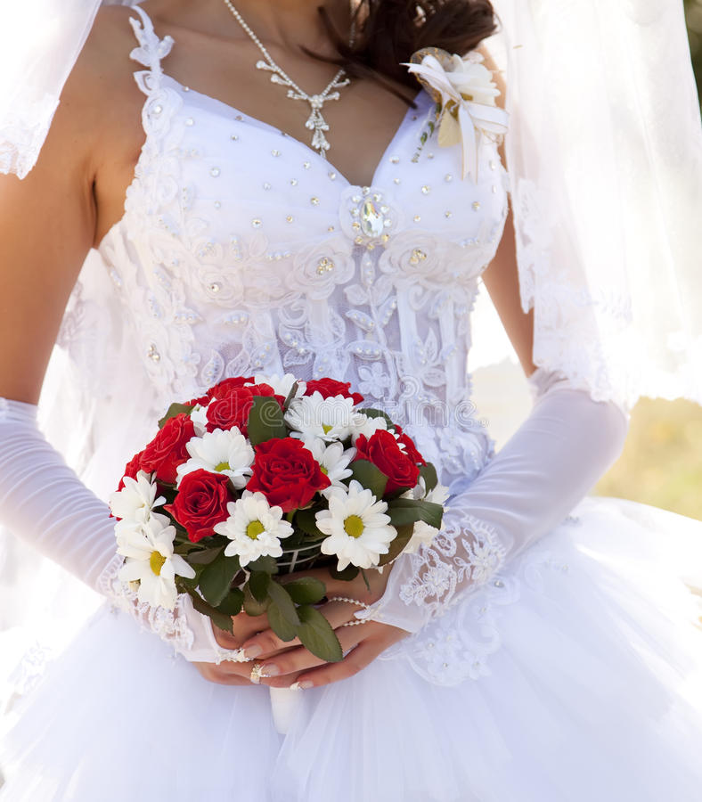 Bride Holding Beautiful Red Roses Wedding Bouquet Stock