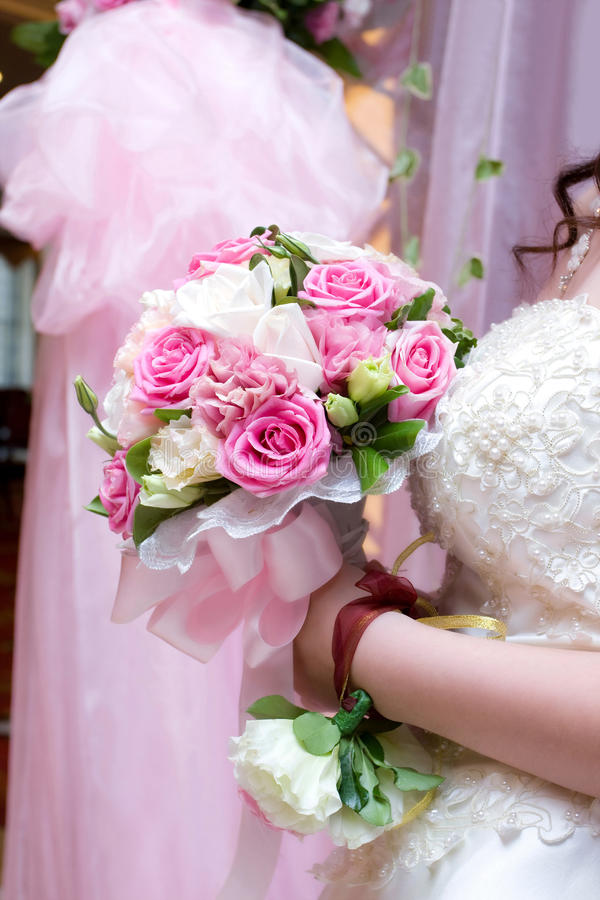 Bride holding bouquet stock photography