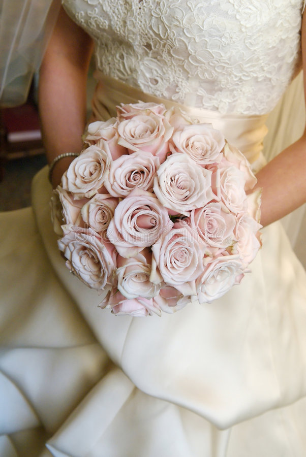 Bride holding bouquet stock image