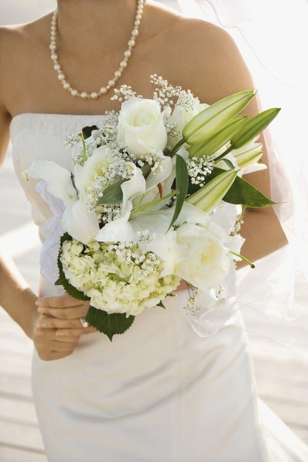 Bride holding bouquet. stock image