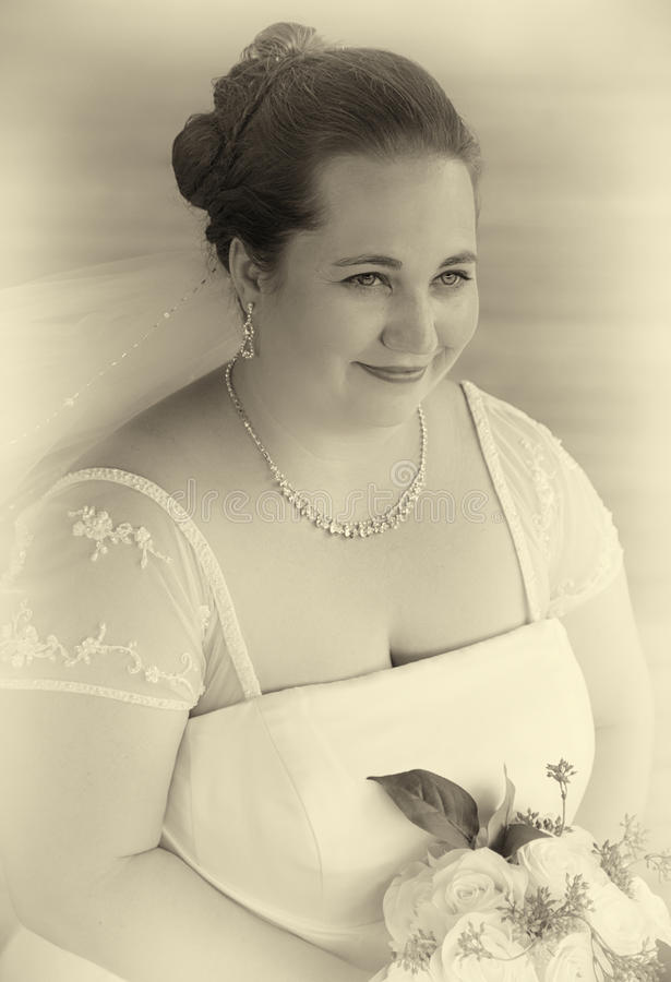 Bride Holding Bouquet in Black and White royalty free stock photography