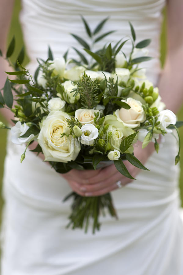 Bride holding bouquet of flowers royalty free stock image