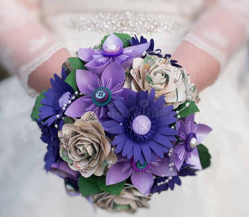 Bride holding bouquet of paper flowers royalty free stock photos