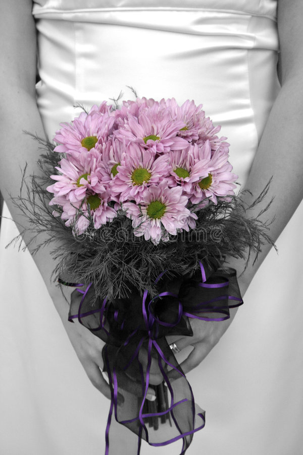 Bride holding bouquet with picture in black and white but flower stock photos