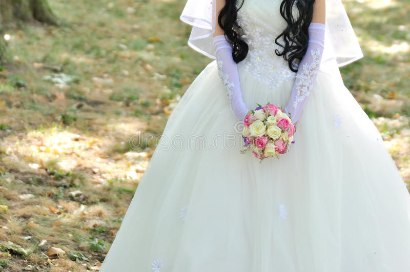 Bride holding colorful bouquet stock images