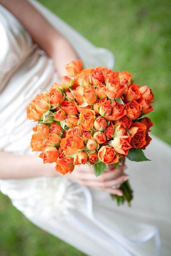 Download The Bride Holding Orange Wedding Bouquet Stock Image - Image of bunch, human: 18375781