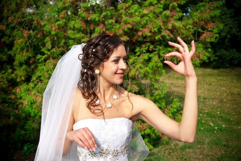 Bride holding ring stock photos