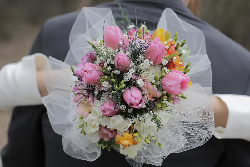 A bride holding wedding bouquet royalty free stock image