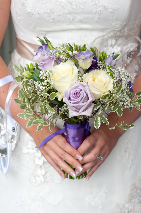 Bride holding a wedding bouquet stock image