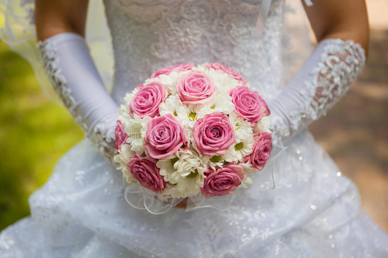 The bride holding the wedding bouquet royalty free stock image