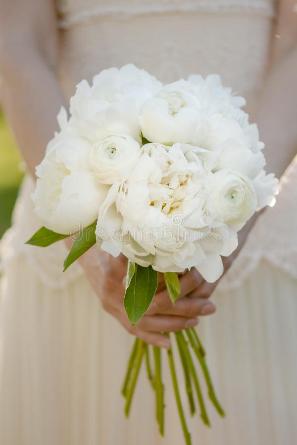 Bride Holding Wedding Bouquet. White Peony Flowers. Classical ...