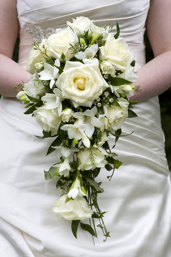 Bride holding a weddingbouquet stock image